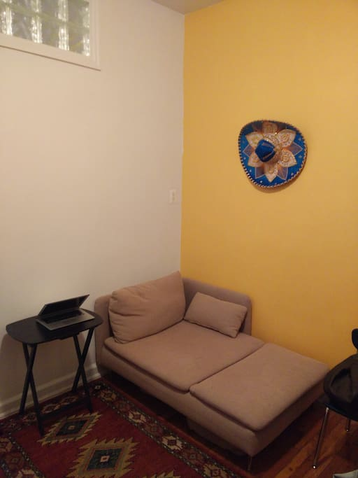 Couch, Desk, Table opposite the kitchen. Can host and also use AirBed for additional space..