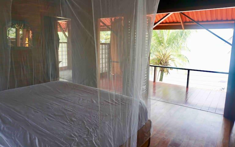main bedroom - upper level - ocean views - large patio