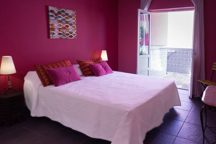 sleeping room with double bed and entrance to the patio