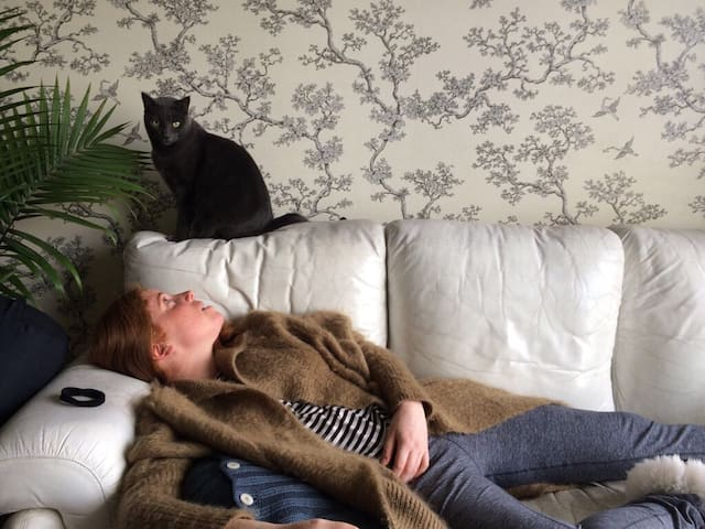 This is me and my cat lazing about on a cold Sunday afternoon