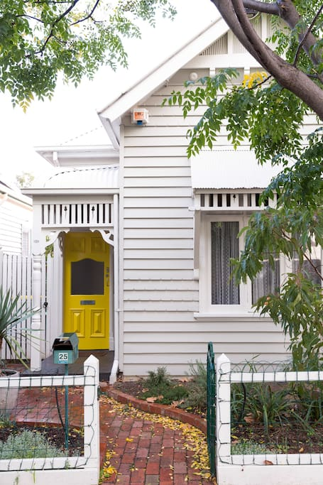 Edwardian weatherboard house with distinct features.