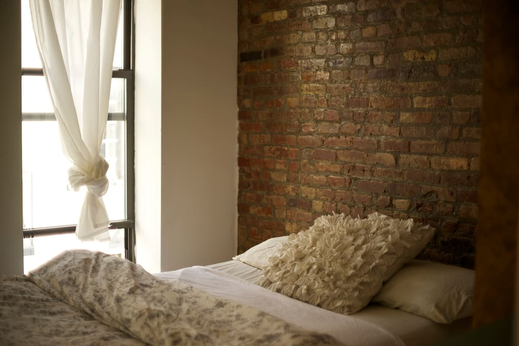 your bedroom exposed brick with two windows