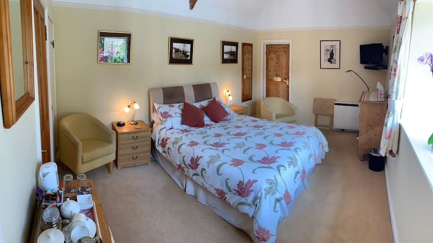 En-suite room with king size bed and garden views