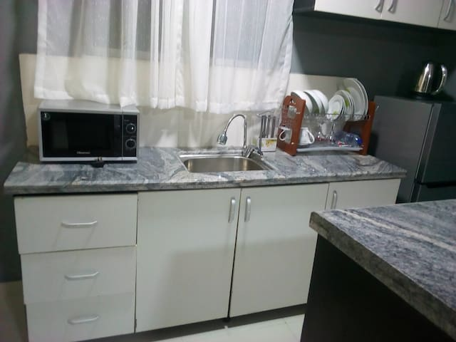 Kitchenette for our guest to own their stay.