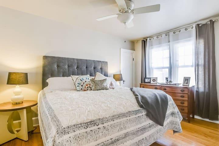 Master bedroom— King bed, mirror, closet, ironing board, iron, dresser, ceiling fan, (incl. room darkening curtains)