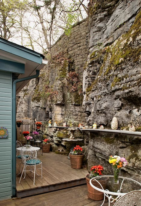 Deck behind Cliff Cottage (Tennyson Suite) with age-old 3-story rock bluff, with Tennyson's 2-person outdoor shower tucked into bluff (shower available April-Oct.)