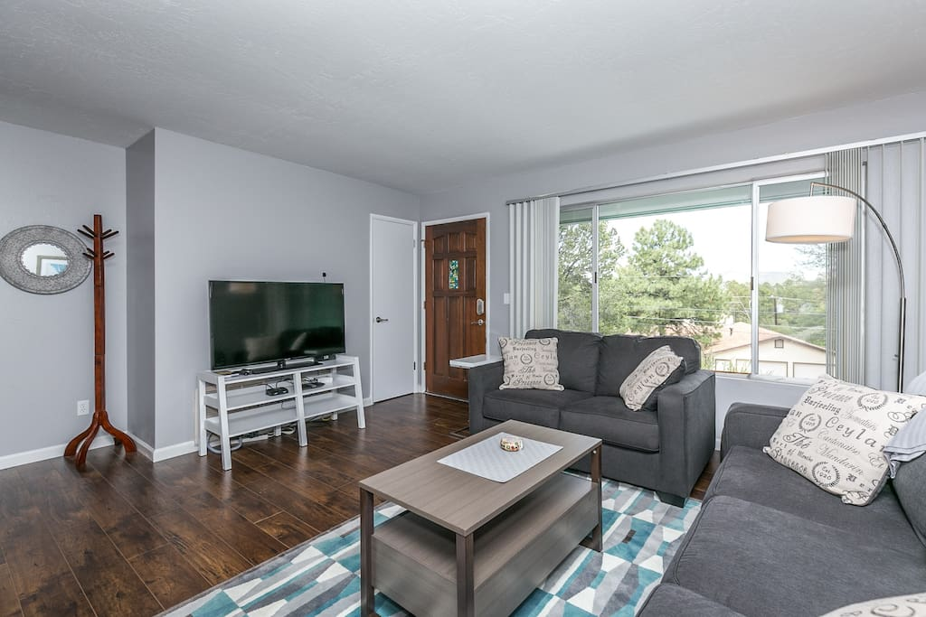 """Family/Living Room #1 - opens to kitchen, new 50"""" TV, new furniture and gorgeous views!"""