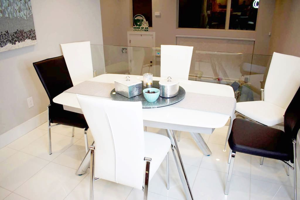 Modern Kitchen. Table has pull out leafs on both ends for additional seating.