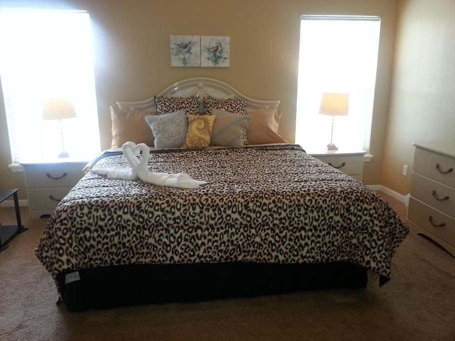 "Master bedroom with king size bed and 32"" TV. It has pool and lake view"