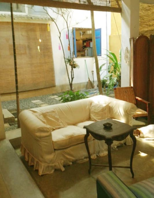 Relax in the sitting area outside the room facing a central courtyard