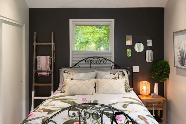 separated bedroom area with blackout shades
