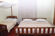 A double bedroom along with a single cot bed accommodation. This bedroom would be suggested for a family as it comes with a single cot making it an excellent family bedroom.