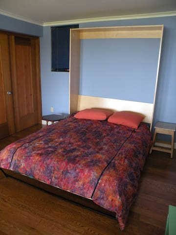 A brand new queen sized bed with a new conventional mattress, down pillows and down quilt