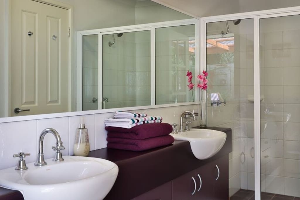 Ensuite bathroom with double showers,and garden views .