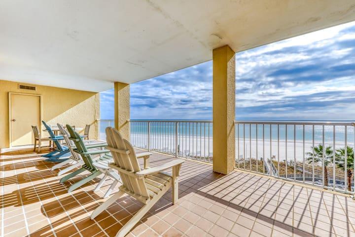 Upscale, beachfront condo w/ a private balcony, shared pools, & beach access