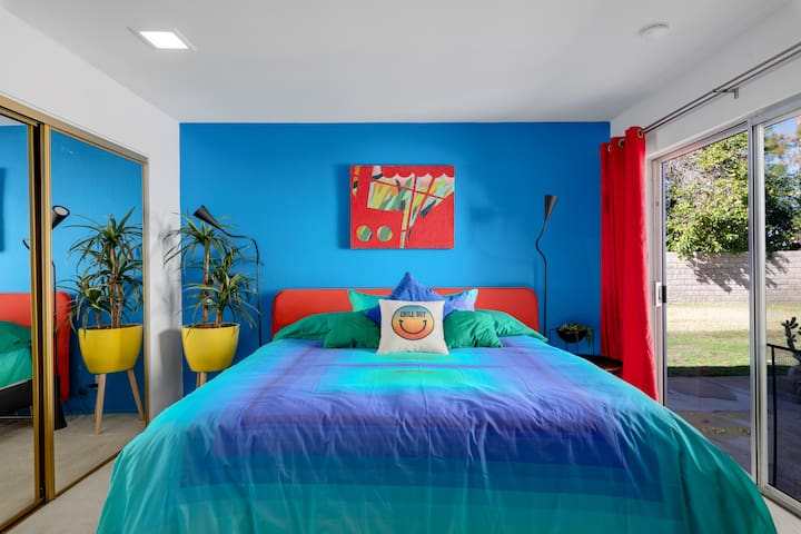 """The appropriately titled, """"Blue Room"""", includes a king sized bed, spacious desk and leads to a private patio with seating"""