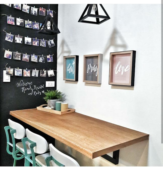 Wall mounted table with elegant breakfast chairs