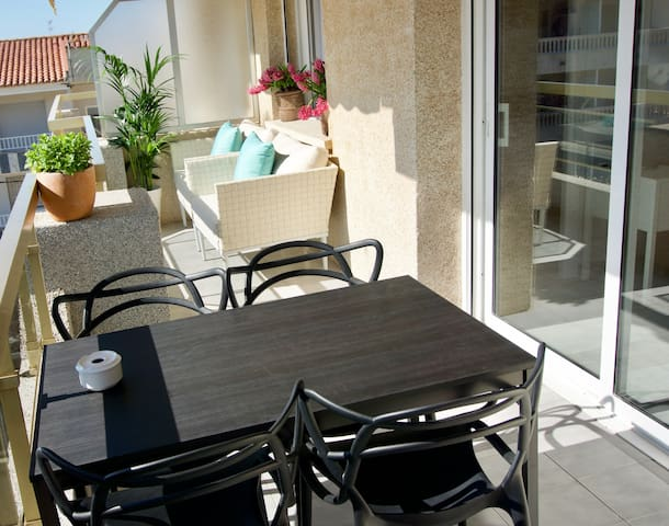 Sunny terrace with big table and chairs