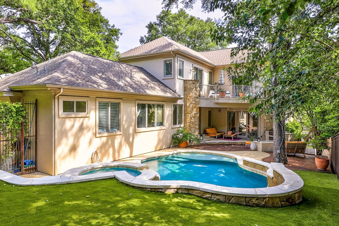 Enjoy luxury amenities such as a sparkling pool, hot tub, home theater, and MORE at this 5BR home tucked away in a peaceful neighborhood just minutes away from downtown.