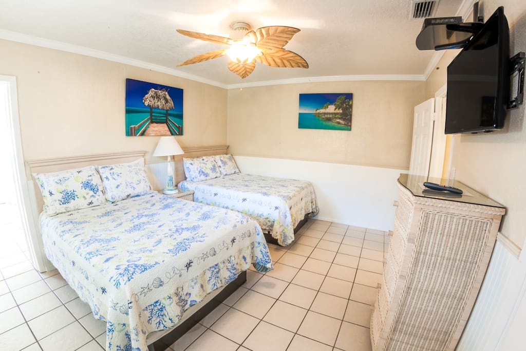 Spacious bedroom with 2 Memory Foam Double Beds and a Flat Screen HDTV with Comcast Xfininty.