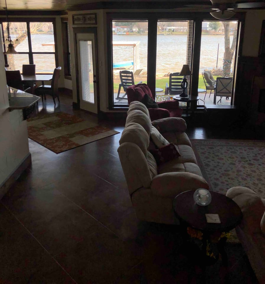 Open concept  living room, dining room looking to lake