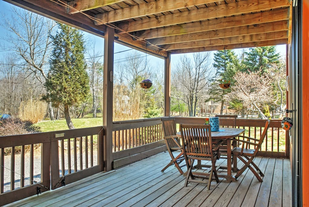 Enjoy a cup of coffee on this beautiful patio among the trees.