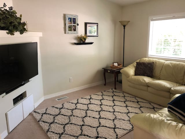 Tv Room, next to the front room, has comfy leather couches, a TV with Netflix, Hulu and Apple TV. There is also an Xbox.