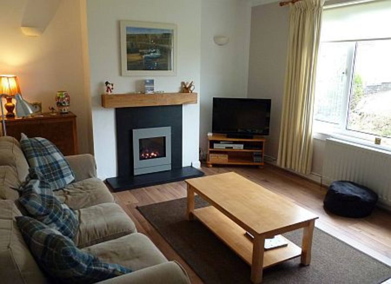 Living room with fireplace and gas fire.  freeview/internet TV & DVD.