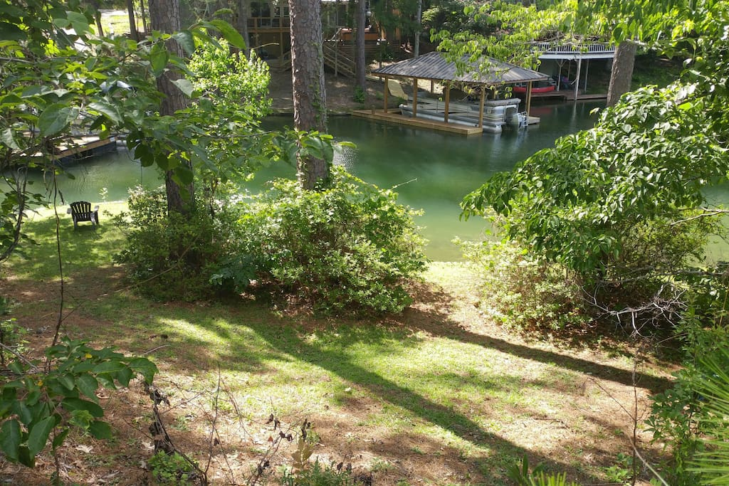 the front yard view. the north portion of property follows a scenic creek. great for fishing, exploring or just sit on top deck and drink coffee or barbeque at sunset and watch fish and turtles swim by.