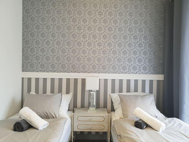 Art Déco bedroom with comfortable beds