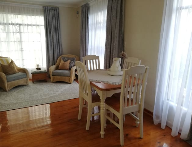 Diningroom table and chairs in front of kitchenette and comfortable chairs to relax, read a book or enjoy the lovely view.