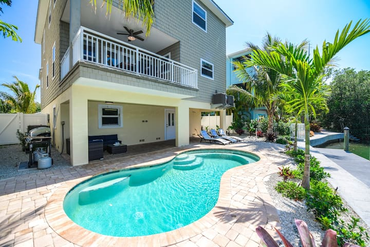 Water front 4 bed/ 3.5 bath luxury home, pool, views for days! On Pine Avenue!
