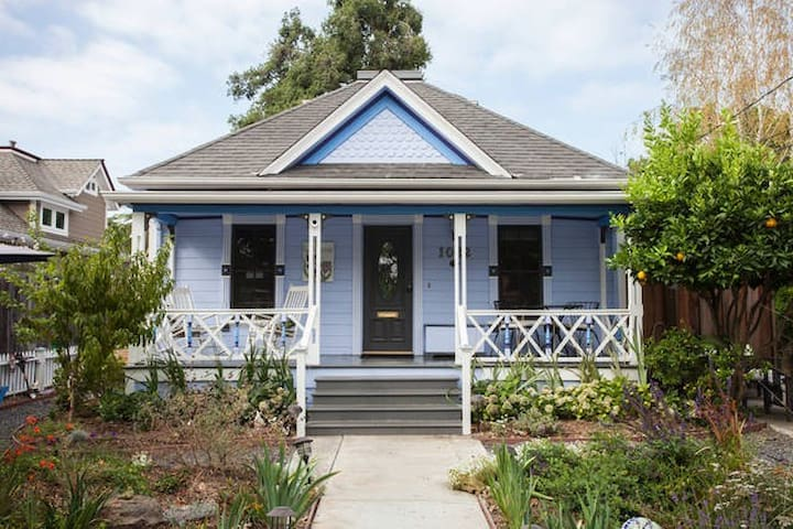 Painted lady Victorian house with cheerful colors to greet you