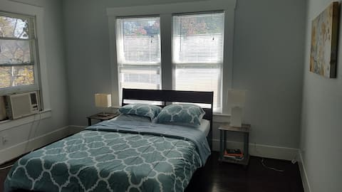 "Bedroom with queen-size 8"" memory foam mattress"