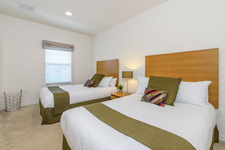 Guest bedroom has 2 full beds (can sleep up to two people each).