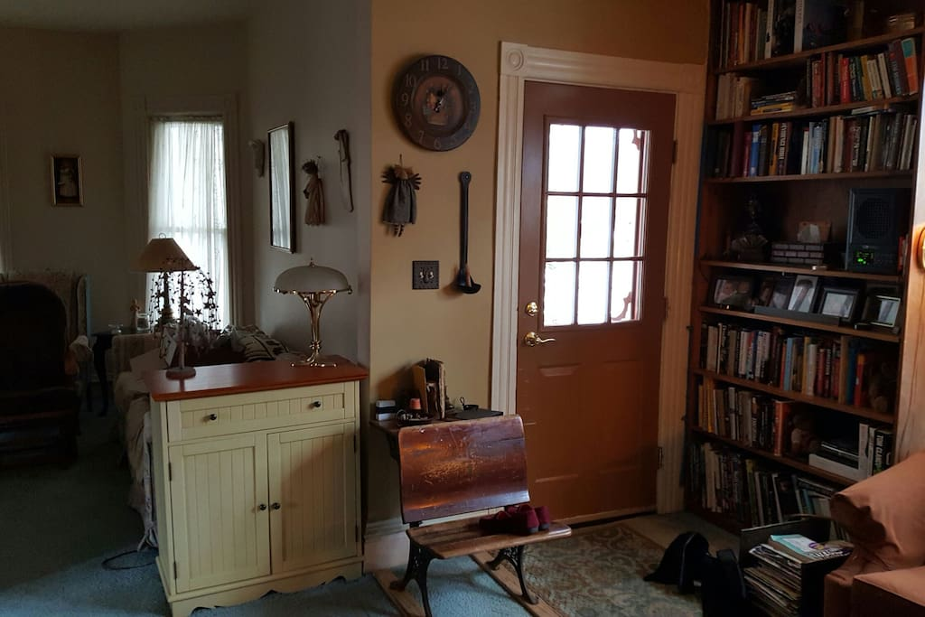 An inside view of our front door with a peak into the living room.