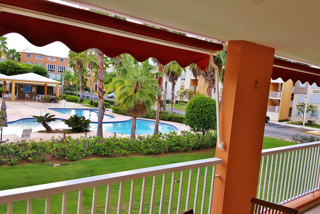 Balcony with a Direct view to the 3 Pools lounging area & at your right beach view