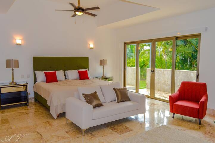 Spacious bedroom with comfortable chair and sofa