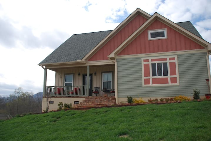 Landrum home with garden and mountain views