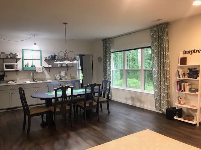Large living space includes place to exercise and for kids to play. Large screen TV, couch and twin beds in this area as well.