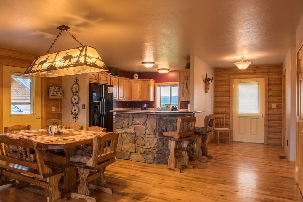 The kitchen is open, warm, and spacious (perfect for eating, visiting, and playing board games).