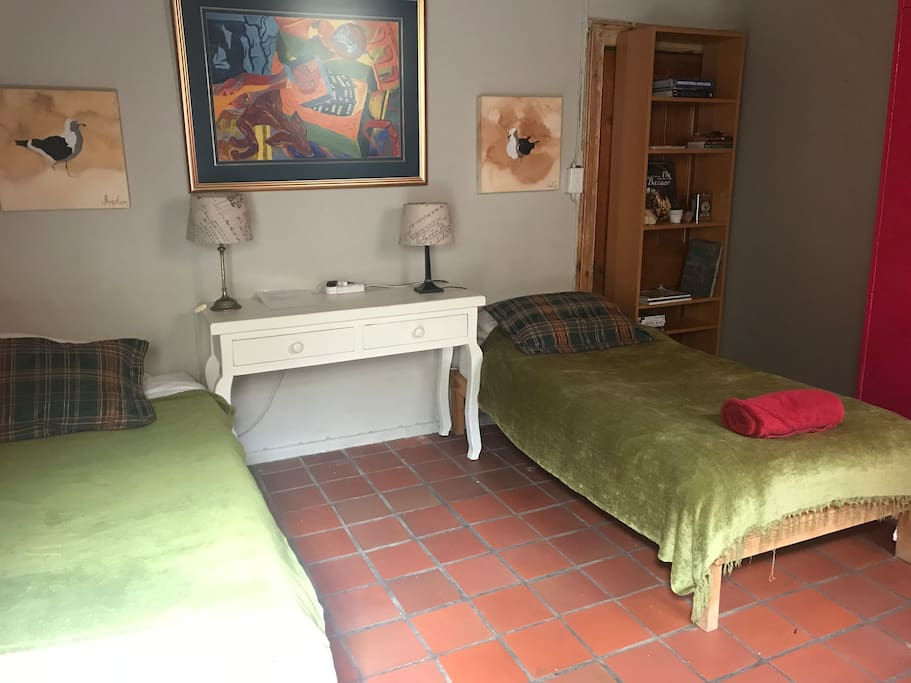 Two comfortable Single beds, large space for your stuff and bookshelf in the right of the picture.