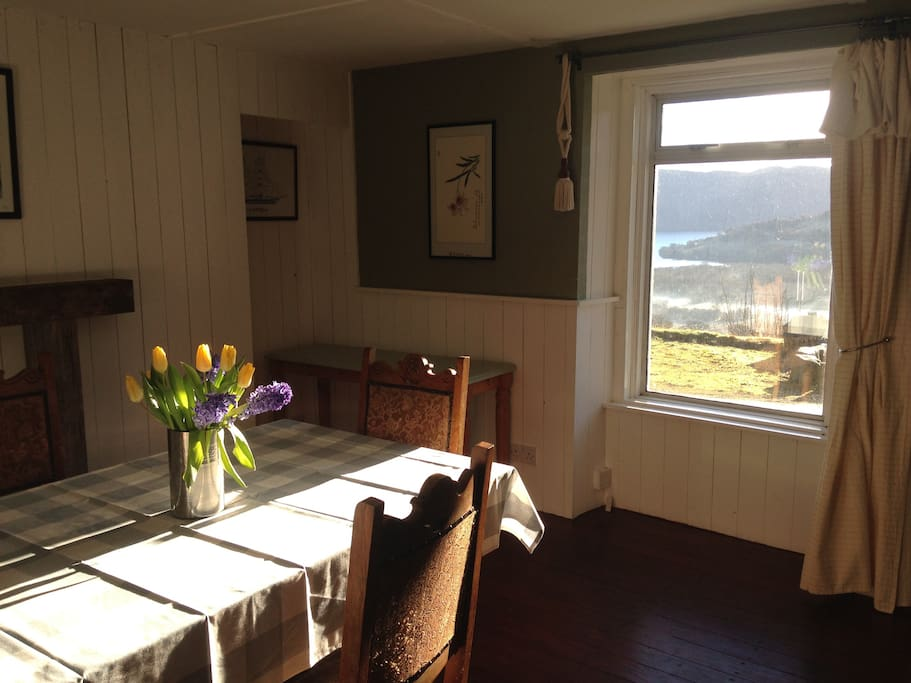 The dining room looks onto Loch Ness and has seating for 4