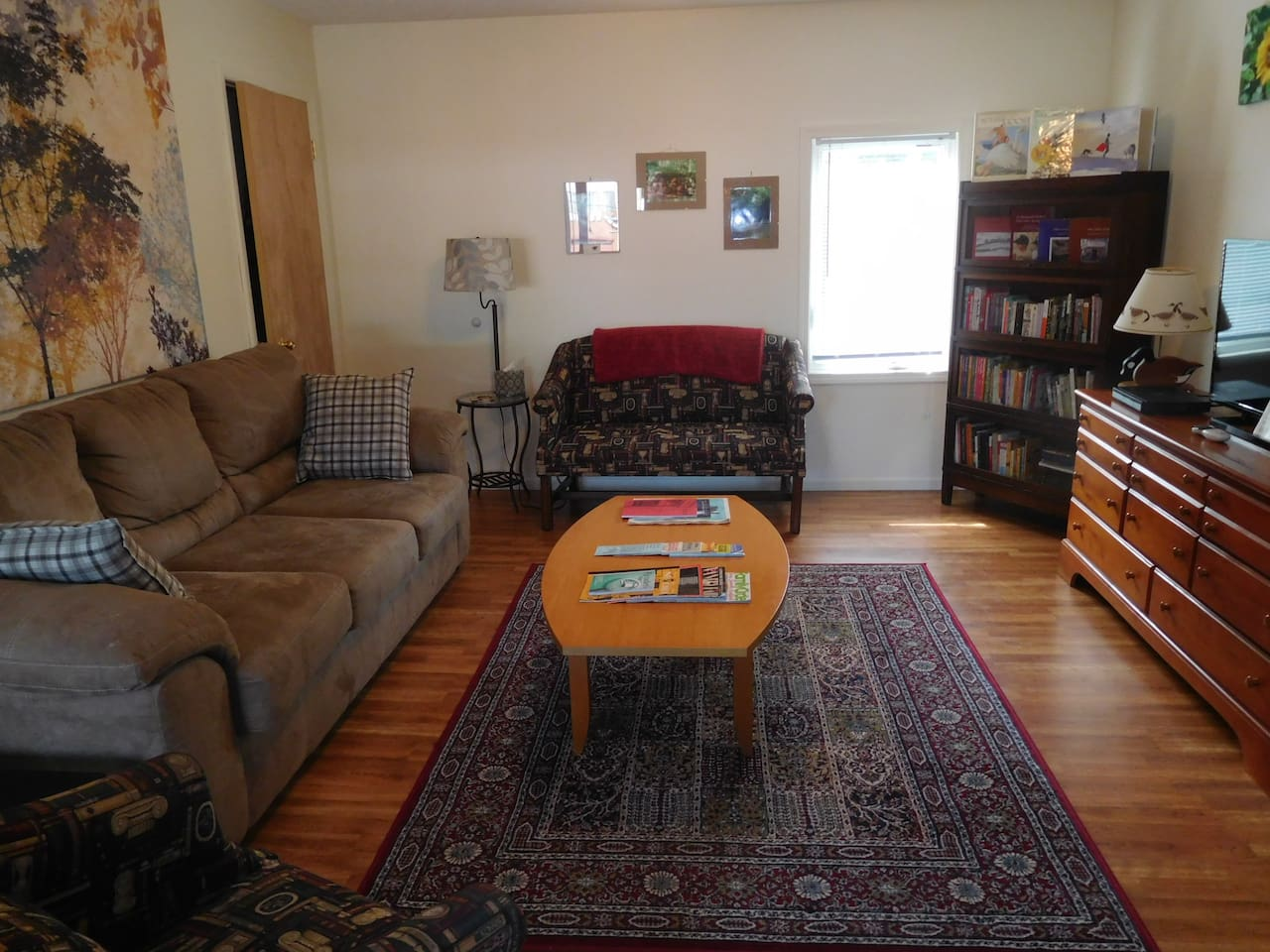 Living room with queen sleeper sofa (memory foam mattress, too!).