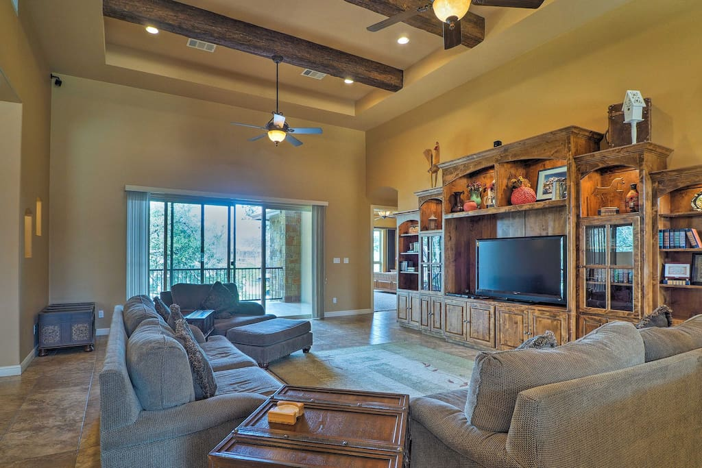 Sit back on the plush furnishings and watch the flat-screen cable TV.