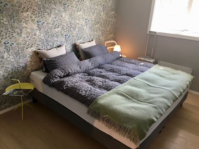 The master bedroom has a high quality (Dux) king size bed that is wide enough for friends to share. (180cm X 200cm).