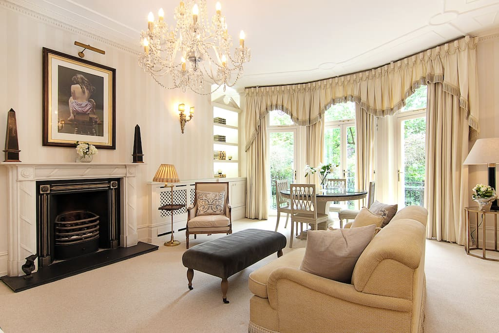 The elegant original fireplace in this lovely Studio apartment