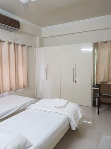 Third Bedroom (Air conditioned) - Another View - All bedrooms have 2-Big single beds which can be converted into a double bed if needed.  Each bedroom has 2 or more big cupboards. Soft cotton bed sheets from IKEA, Comforters etc. are also provided.