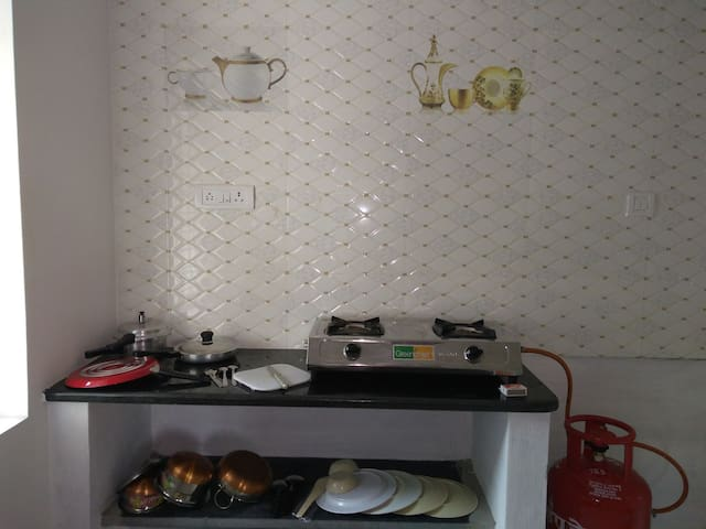 private kitchen with utensils and gas stove to cook