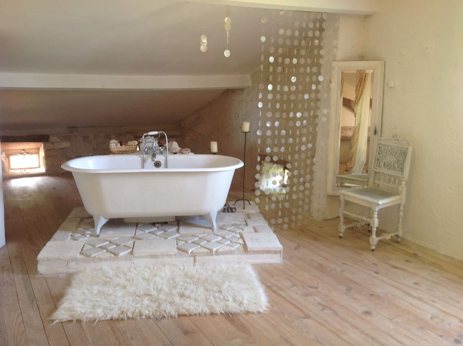 Free standing bath,looking out through a round window